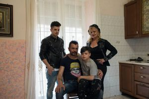 The Doria family poses at their home in Casalnuovo. From the left: Ivan Doria, 19, Gianni Doria, 42, Eman Doria, 9 and Maria Doria, Gianni's mother. All of them are singers.