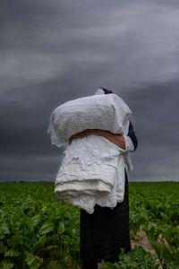 Nun in beet field