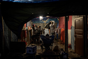 "Barber shop in the Jungle camp.Daily life of refugees at the so-called ""Jungle"" migrant camp in the northern French city of Calais on November 5, 2015."