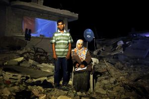 Assan Mohamed Najar, 30, and his 9 month pregnant and blind wife Tahreer Adnan Najar, 27, pose at their destroyed home in Khan Yunis due to Israeli artillery and airstrike during the summer's 50-day war between Israel and Hamas. Despite their difficult and dangerous condition, they have to stay in the destroyed house, since there is no place else for them to move.
