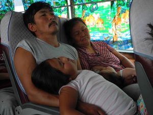 napping family on the bus, Mongolia
