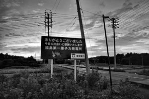 """The roadsign put up by TEPCO at the exit of Fukushima Daiichi nuclear plant reads: """"Thank you for your visit, it was great to meet you, hope to see you soon. -TOKYO DENRYOKU (TEPCO)"""", from the series Fukushima """"No Go"""" Zone, © Pierpaolo Mittica."""