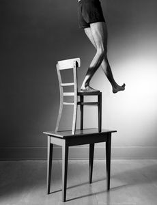 Man, chair and table