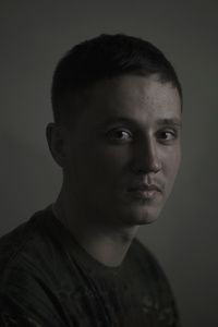 Misha, 23, bank assistant, picture was taken after he spent 9 months in the war zone, March 2015, Ukraine.