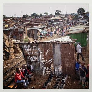 A train track goes through Kibera. The Kibera slum is the largest slum in Nairobi with around half a million inhabitants
