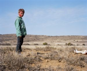 bloodied hunter # IV with buck, south africa-from the series 'hunters'-David Chancellor