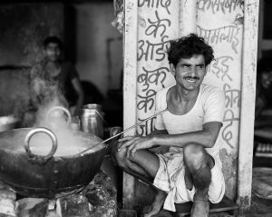 Man cooking on the street.