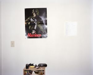 "Sharrod's bedroom (Marines poster). From the series ""I slowly watched him disappear"" © Jason Hanasik"