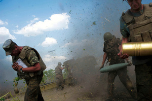 GODS OF WAR. Ukrainian servicemen, who are members of an artillery section, take cover after firing a cannon during a military operation against pro-Russian separatists near Pervomaisk, Luhansk region on August 2, 2014.