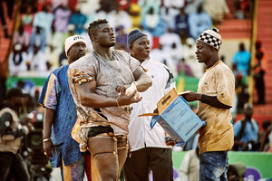 Balla Gaye 2 releases several pigeons in the stadium of Demba Diop before the with 200 millions CFA (approx. 300'000 USD) endowed fight against wrestler Emeu Sene, April 5, 2015. The release of the pigeons is a mystic ritual which should bring luck. The wrestler who's real name is Sakko, became a superstar in Senegal after he dethroned the 15 years unbeaten champion Yekini in 2012.
