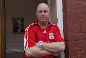Steven Hoydens, the only red Liverpool supporter in a street full of blue Everton Supporters. Everton, Liverpool 13 May 2007.