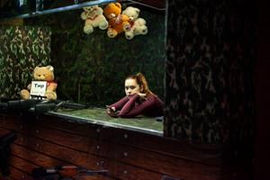 Girl in Shooting Gallery