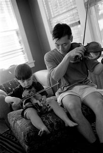 Jackson Whang (3)plays violin with his dad, John.   His mother, Lauren's, ancestors came in US in 1600s (DAR).  He is a descendent of President Franklin Pierce.  Ethnicity:  Korean • Russian Jewwish • Irish • English ©2014, Stephen Shames
