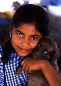 Latina girl with puppy
