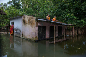A family trapped in the flood water at Tala, Satkhira, Bangladesh