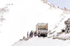 STANDING IN THE SNOW. A STOP DURING THE JOURNEY AT 5,000M