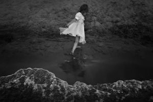Girl playing with waves, Samara, Russia, 2014