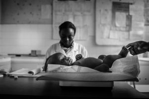 Weighing babies at Malhangalene health center. Maputo, Mozambique.