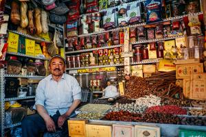 A Uighur man waits for customers at his tea shop at a local market in old Kashgar, Xinjiang Uighur Autonomous Region, China.