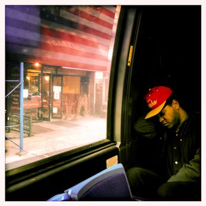 Asleep on the downtown bus, New York, NY
