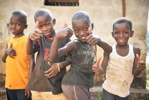 Four children pose for the camera.