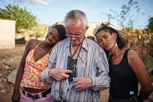 """Father Hermann Klein-Hitpass visits some of the women at their homes in the township to see if they need help. For many decades he stood up for the weakest members of society in Windhoek, but for the past 20 years his special focus has been on girls and women whose poverty forced them into sex work. Most of those women do not only call him """"Father"""" because he is a priest – many say that he is like"""