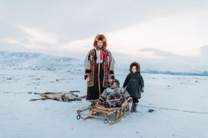 Nenets family and reindeer's skin