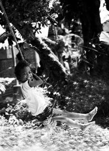 Ati Child plays in a rope