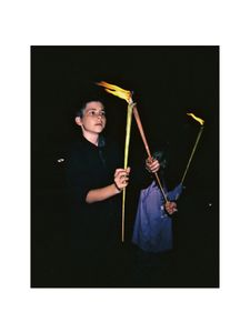 Boy with torches