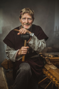 Traditional crafts. Portrait of the Wooden Cross Maker