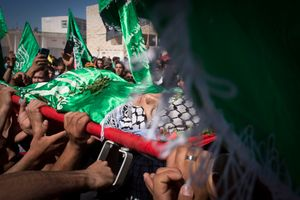 Palestinians carry the body of Orwa Hammed, a 14-year old, who was shot by Israeli soldiers during clauses in his West Bank village of Silwad, 2014.