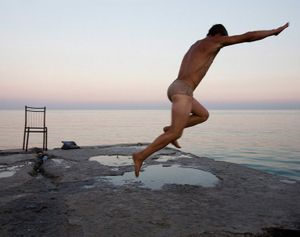 "A young man diving into the Black sea, Ukraine. From the series ""From the Mountains and to the Sea"" © Nadia Sablin"