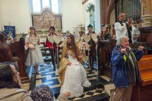London May Queen in Hayes Parish Church during cloudburst, 2013  © Peter Marshall