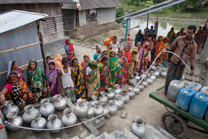 People gather to collect drinking water from Reverse Osmosis Plant of an NGO's Project in Shyamnagar, Satkhira, Bangladesh.