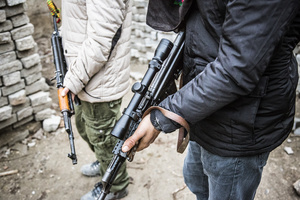 Kalashnikov weapons of YPS guerilla fighters while training between high barricades in Kurdish-dominated city of Nusaybin in southeast Turkey, near the Syrian border. Heavy gunfights took place during several curfews between Turkish government special forces and Kurdish YPS guerilla fighters.