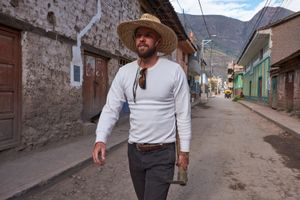 Aaron Ebner walks to his farming plot up the mountainside from the town of Calca