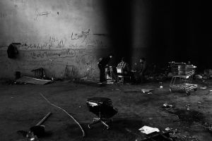 Immigrants from Afganistan in an abandoned factory.  Enri Canaj