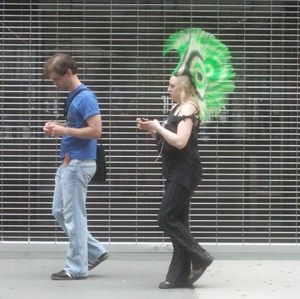 Outside Museum of Modern Art NYC checking cellphones