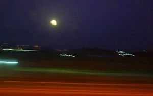 Lights in Full Moon Night Above Galilee's Mountains While Driving.