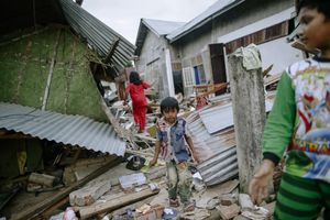 The children playing at their destroyed home due to 6.5 magnitude earthquake in Pidie Jaya, Aceh province, on December 10, 2016.