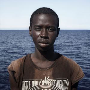 Mediterranean Sea, 1 August 2016. Alsaine (17), from Guinea, poses for a portrait minutes after being rescued on the Mediterranean Sea, 20 nautical miles off the Libyan coast by a rescue vessel provided by the NGO Jugend Rettet. The rubber boat in which he travelled carried 118 people on board, who were transferred by the Italian Coast Guard to Lampedusa (Italy).