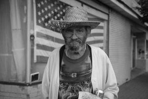 Man in a straw hat, Kingston, NY.