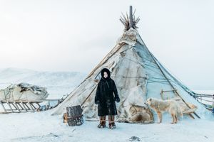 A Nenets boy and his family's nomadic  house