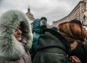 Crowd wearing Russian-style fur hats and fur-collared hoods on this cold day in Independence Square, February 2014.