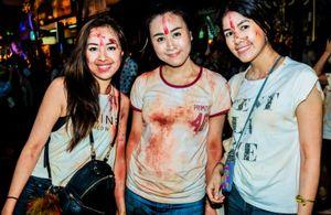 Three young woman enjoying Dussehra festival in Bangkok, Thailand