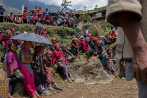 Most of villager gather on the plateau in front of Gumba village wait for the helicopter to deliver relief material. Before the earthquake 7.3 magnitude