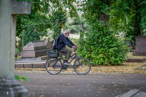 Man Riding Through Cemetery
