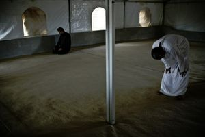 Praying in one of Zaatari's mosques. © Tom Verbruggen