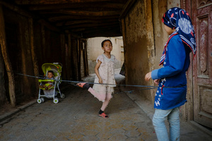 Uighur kids playing at the outside of their house in old Kashgar, Xinjiang Uighur Autonomous Region, China.