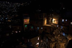 "A view of Rocinha at night. ""The process is only sustainable if you are capable of reducing poverty and inequality,"" says Andre Urani, executive director of the Institute for Studies on Work in Rio. © Manu Valcarce"